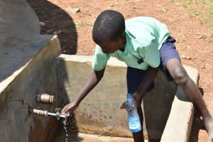 The Water Project:  Student Gets Water From The Tank