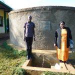 The Water Project: Eshikufu Primary School -  Field Officer Protus Ekesa With Head Teacher Osundwa