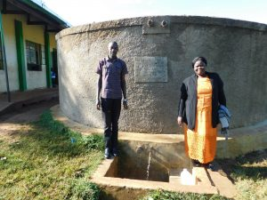 The Water Project:  Field Officer Protus Ekesa With Head Teacher Osundwa