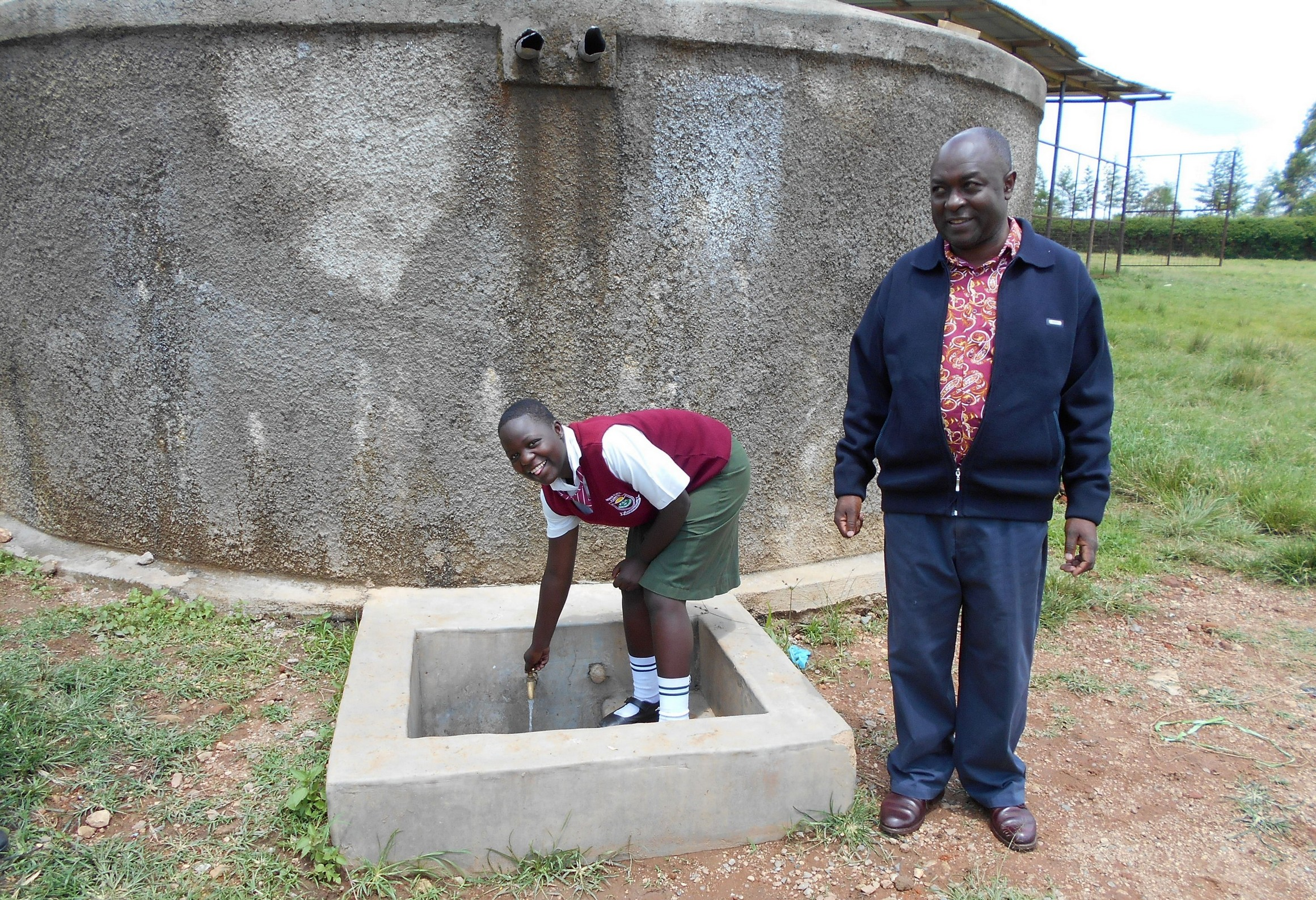 The Water Project : 2-kenya18315-cynthia-and-principal-patrick-amalemba