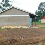 The Water Project: Kimangeti Primary School -  Wire Laid For Rain Tank Foundation With Water In The Background