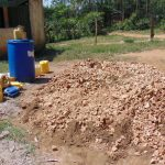 The Water Project: Lwanga Itulubini Primary School -  Rock And Water Collection For Construction