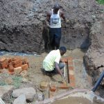 The Water Project: Shihungu Community, Shihungu Spring -  Brick Setting