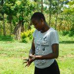 The Water Project: Ikonyero Community, Amkongo Spring -  Angeline Nafula Washing Her Hands