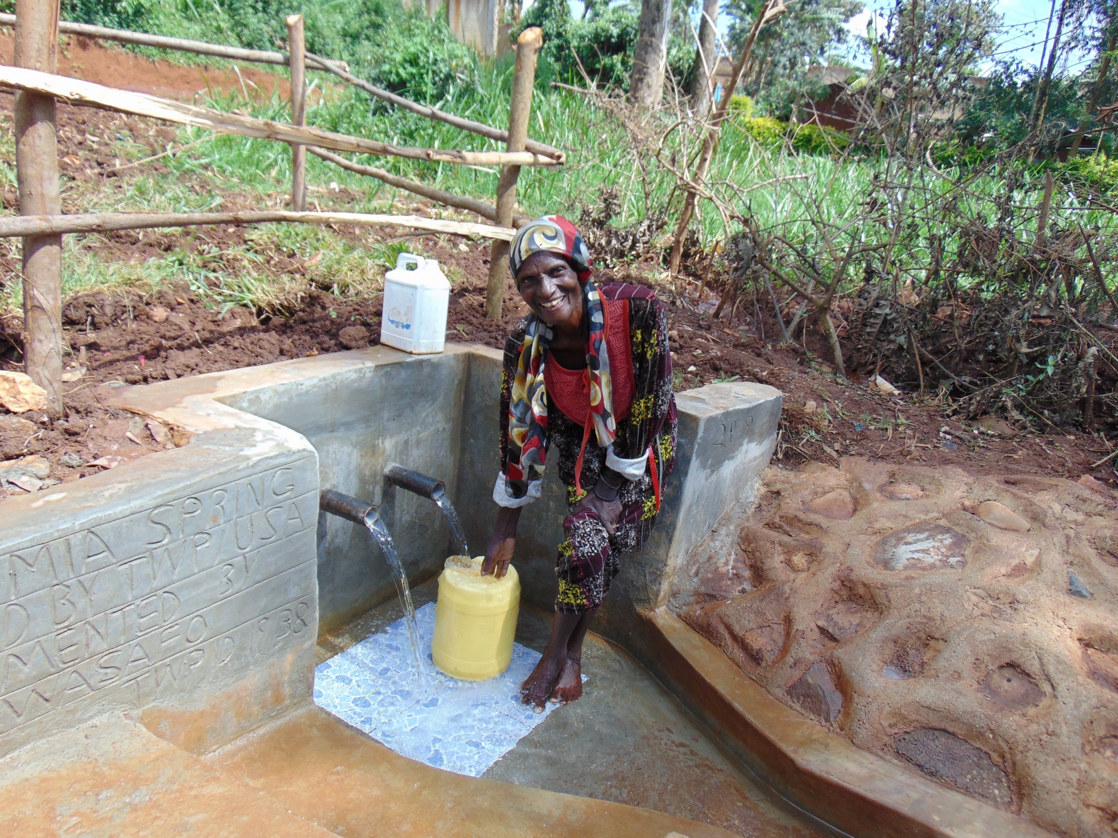 The Water Project : 21-kenya19138-happy-filling-up