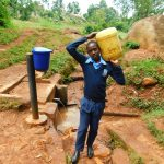 The Water Project: Kerongo Secondary School -  Edwin Oranja Carrying Water
