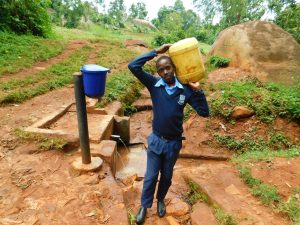 The Water Project:  Edwin Oranja Carrying Water
