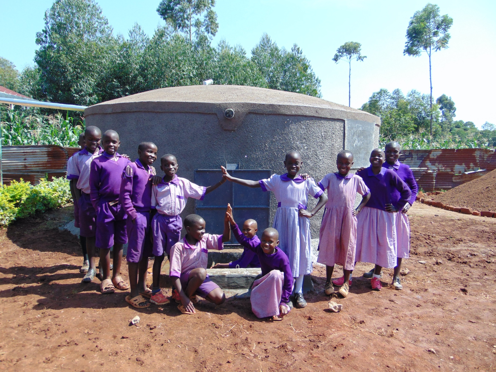 The Water Project : 24-kenya19042-students-with-the-new-tank