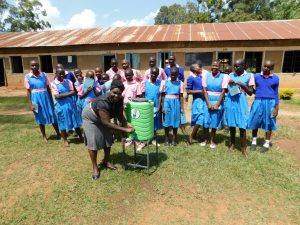 The Water Project:  Students Giggle As A School Administrator Uses The Handwashing Station