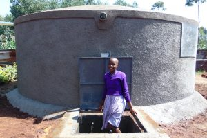 The Water Project:  Student With Rain Tank