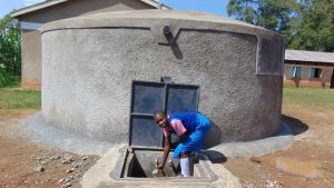 The Water Project:  Getting A Drink From The Tank