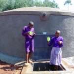 The Water Project: Magaka Primary School -  Enjoying A Fresh Drink