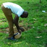 The Water Project: Ikonyero Community, Amkongo Spring -  Field Officer Jonathan Mutai Demonstrates Tippy Tap Construction