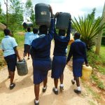 The Water Project: Kerongo Secondary School -  Carrying Wateer Back To School