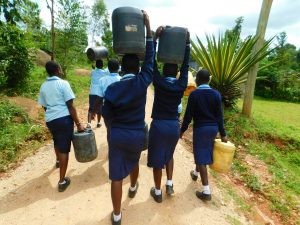 The Water Project:  Carrying Wateer Back To School