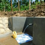 The Water Project: Ikonyero Community, Amkongo Spring -  Clean Water Flows From Newly Completed Amkongo Spring