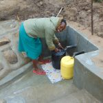 The Water Project: Sasala Community, Kasit Spring -  Happy Fetching Clean Water
