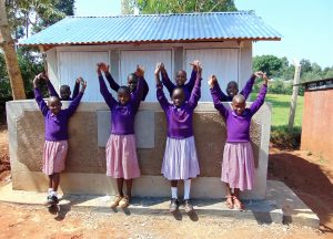 The Water Project:  Girls In Front Of New Latrines