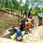 The Water Project: Ikonyero Community, Amkongo Spring -  Fetching Fresh Water