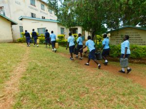 The Water Project:  Delivering Their Water To School