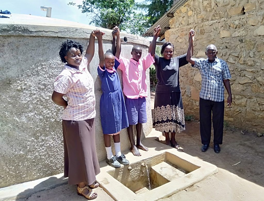 The Water Project : 3-kenya18054-madam-misiko-linda-moses-field-officer-karen-and-head-teacer-mr-mukasa-indeche