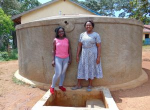 The Water Project:  Field Officer Laura Alulu With Mrs Mideva
