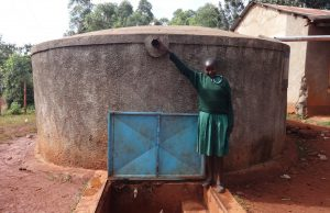 The Water Project:  Noreen Reaches For The Pverflow Pipe