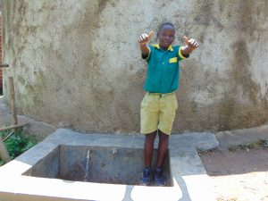 The Water Project:  Student At The Rain Tank