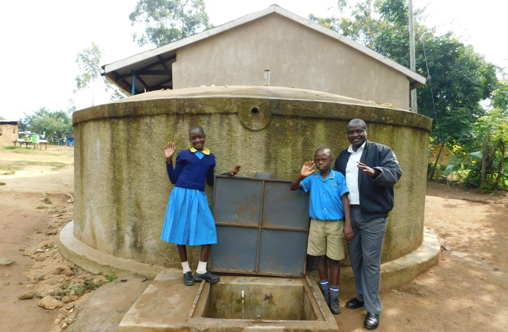 The Water Project : 3-kenya18076-mr-imbenzi-with-students-at-the-rain-tank