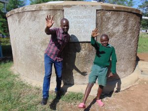 The Water Project:  Field Officer Victor Musemi With A Student At The Rain Tank