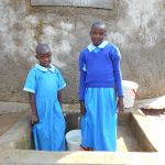 The Water Project: Shivanga Primary School -  Beatrice And Anne At The Rain Tank