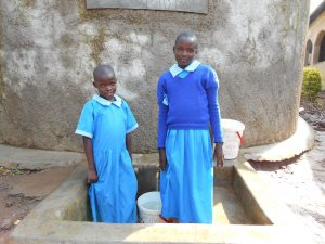 The Water Project:  Beatrice And Anne At The Rain Tank