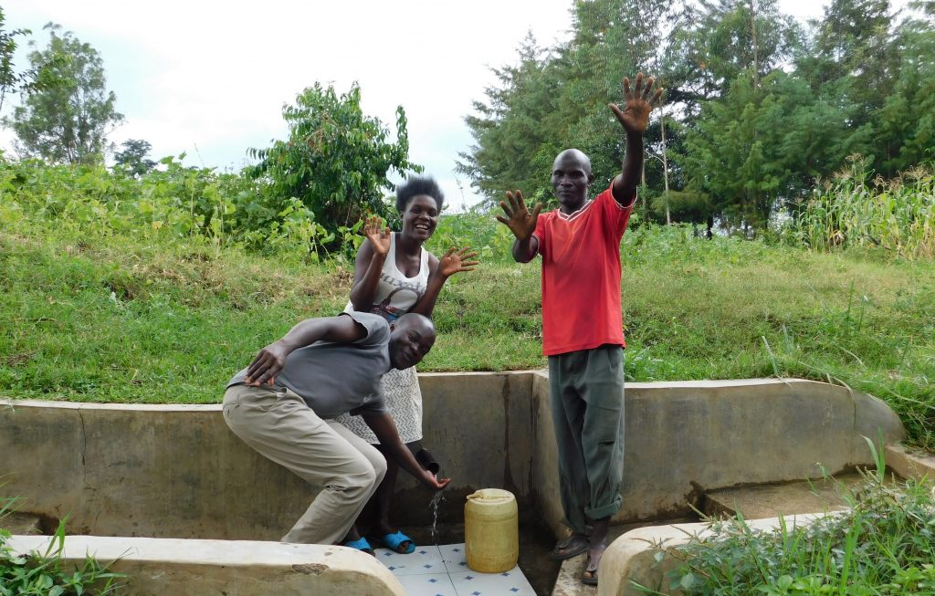 The Water Project : 3-kenya18088-field-officer-victor-musemi-with-yvonne-and-jeremiah