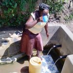 The Water Project: Matsakha Community, Mbakaya Spring -  Medline Takes A Drink