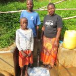 The Water Project: Handidi Community, Chisembe Spring -  Water Committeee Chair Mr Indimuli With Michelle And Betty
