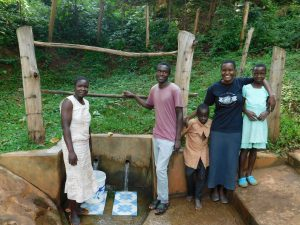 The Water Project:  Victor Musoga Center With Bravin And Field Officer Rose To This Right