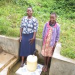 The Water Project: Emachembe Community, Hosea Spring -  Field Officer Betty With Lilian Nechesa
