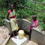 The Water Project: Ivinzo Commuity, Mushianda Spring -  Truphena And Rose Fetch Water