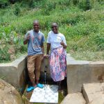 The Water Project: Emaka Community, Ateka Spring -  Mathew With Field Officer Joan Were