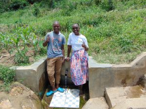 The Water Project:  Mathew With Field Officer Joan Were