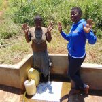 The Water Project: Shirugu Community, Jeremiah Mashele Spring -  Maureen With Field Officer Jemmimah At The Spring