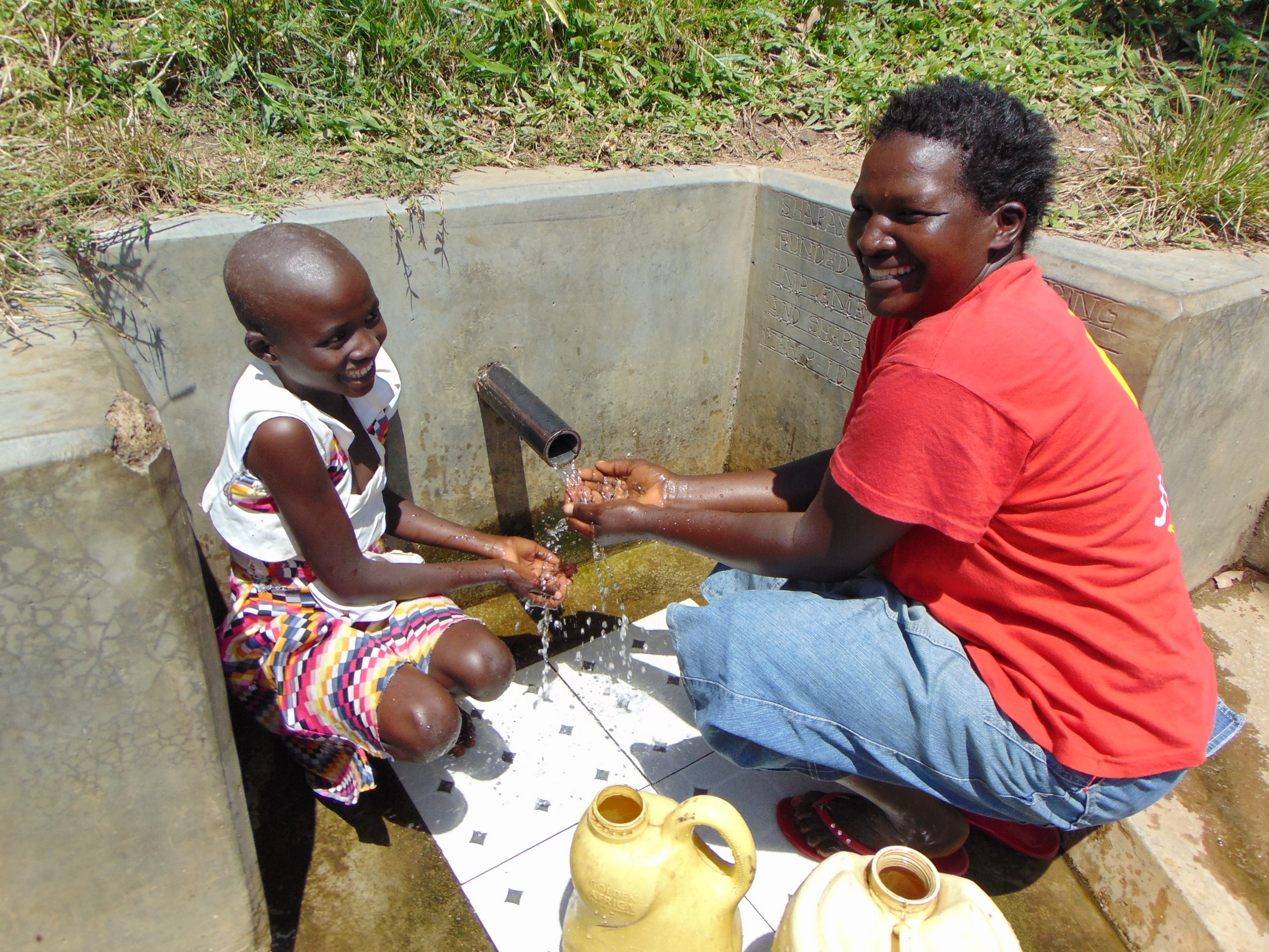 The Water Project : 3-kenya18153-celestine-and-violet-enjoying-the-spring-water