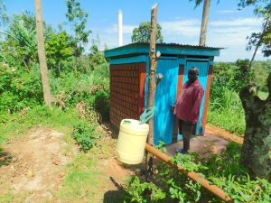 The Water Project:  David Vidinyu With His Tippy Tap And Latrine Structure He Built Over His Sanitation Platform