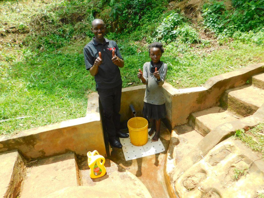 The Water Project : 3-kenya18158-faith-lukhanji-with-field-officer-wilson-kipchoge