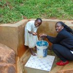The Water Project: Chepnonochi Community, Chepnonochi Spring -  Field Officer Laura Alulu With Sarah
