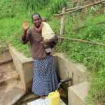 The Water Project: Shitoto Community, Mashirobe Spring -  Judith Fetching Water
