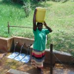 The Water Project: Irumbi Community, Shatsala Spring -  Joyce Vihenda Ready To Carry Water Home
