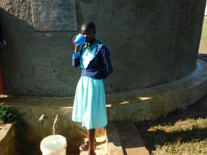 The Water Project:  Vivian Osunya Drinks From The Rain Tank