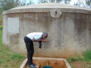 The Water Project:  Renson Takes A Drink From The Rain Tank