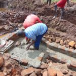 The Water Project: Lutonyi Community, Lutomia Spring -  Cementing The Foudnation